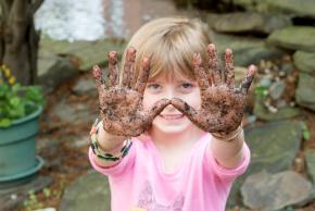 girl with soil on hands