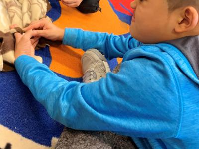 Ms. Ghazanfar's 1st and Ms. Ghazanfar's 2nd grade classes work hard to tie knots in their blankets.