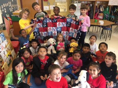 Mrs. Giacomo's class is so excited to give their blanket to a local animal shelter.